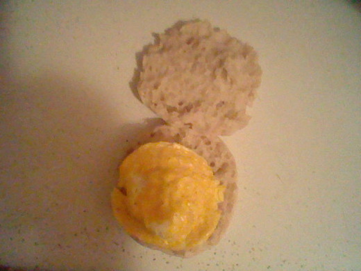 Place the egg on the center of the muffin.