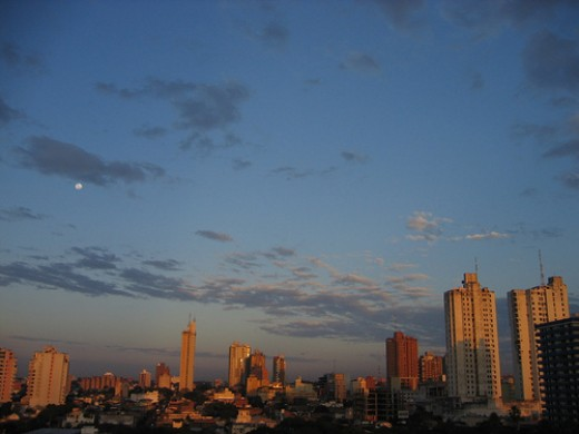 Asunción at sunset.  Picture taken by Alex-S and licensed under Creative Commons Attribution License Version 2.0.