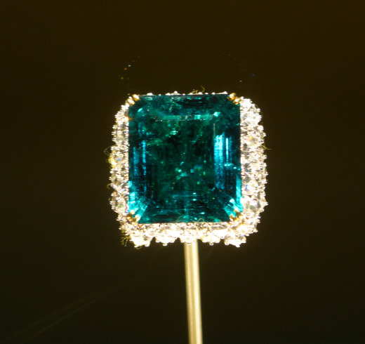 The emerald is set within a cluster of 60 pear-shaped diamonds weighing a total of approximately 15 carats. The royal rulers of Baroda, a state in India, once owned the emerald in this ring. It was the centerpiece of an emerald and diamond necklace w