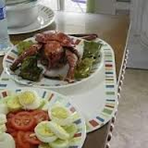 Coconut  lobster served with fresh tomatoes and cucumbers from my vegetable garden at Chateau Du Mer, Boac, Marinduque