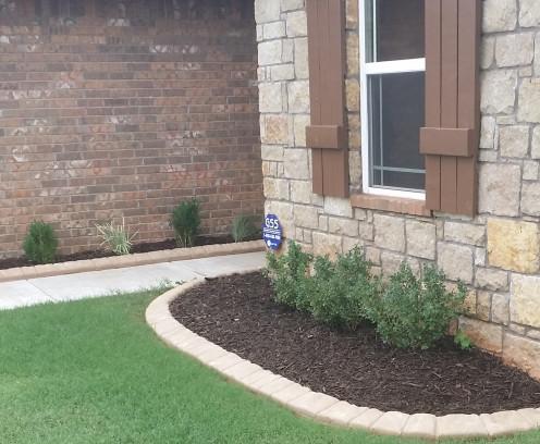 Clean flowerbed...looks great.