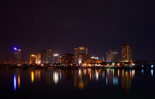 Night time view of the Manila skyline taken by Vanessa David and licensed under Creative Commons Attribution License Version 2.0.