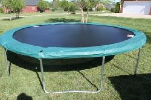 Safety pad on trampoline springs and top rail