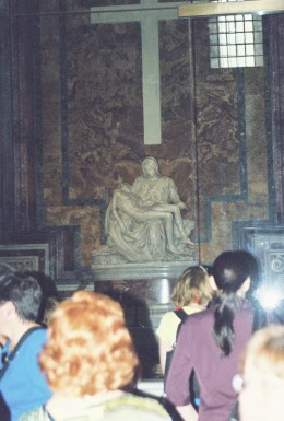 "Michelangelo's ""La Pieta,"" the marble statue depicting Mary holding Jesus. It's now behind glass because of vandalism."