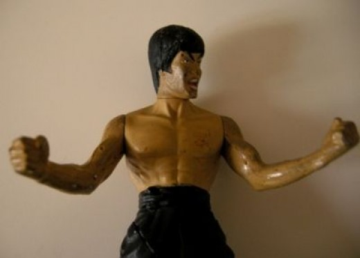 A very dirty action figure pre-cleaning