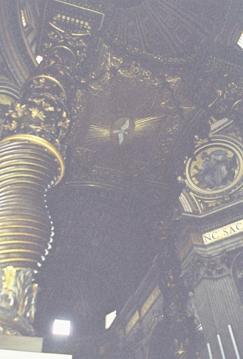 Looking up into the Baldacchino. Lots of dark wood & gold.