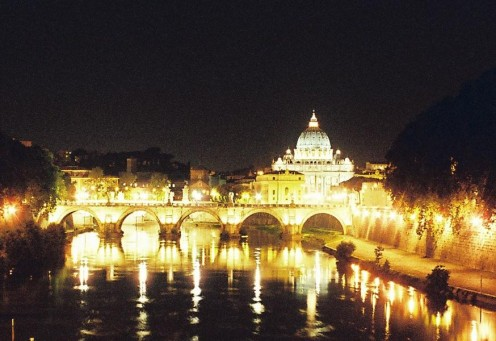 Saint Peter's Basilica and Ponte Sant'angelo, beautifully reflected in the Tiber River.