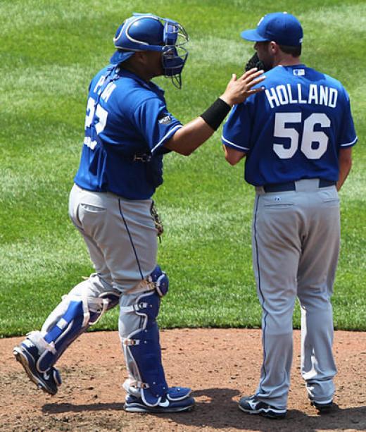 Kansas City Royals catcher Brayan Pena (27) and relief pitcher Greg Holland (56)