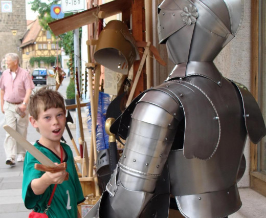 My son selecting a sword as a souvenir.