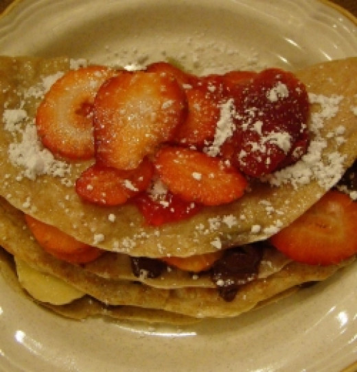 This double decker crepe contains strawberries, bananas, chocolate chips, and powered sugar!