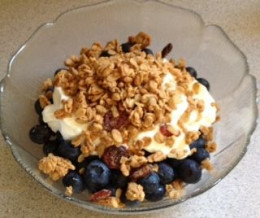 Sprinkle the granola on the blueberries and yogurt