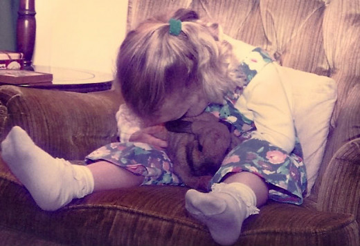 My daughter and our first house rabbit: Benji.