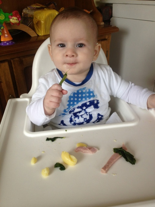 Our Baby Led Weaning journey: Trying some kale.