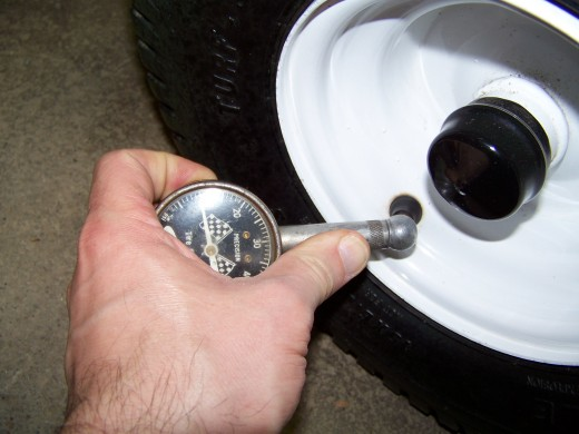 Consult your tractor manual for the proper tire pressure.