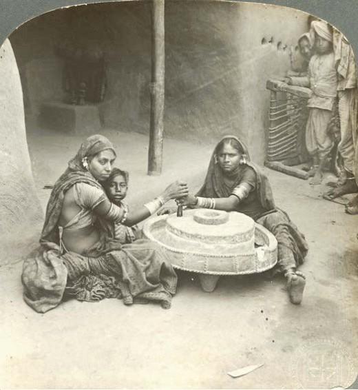 Hindu House wife's grinding flour