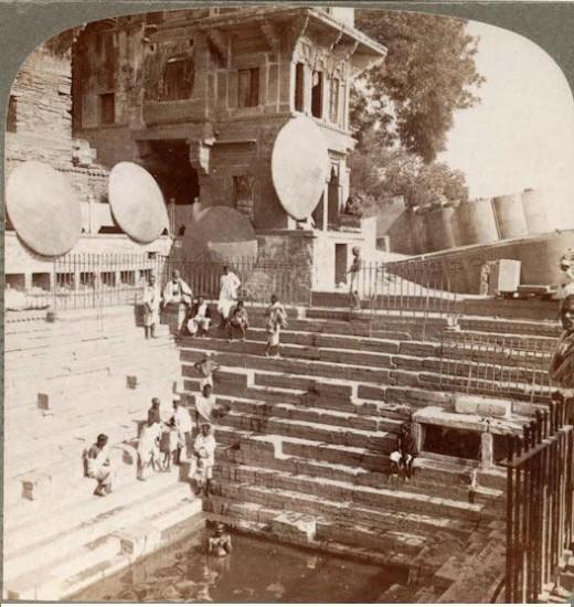 Hindu Pilgrims bating in scared well of their god vishnu