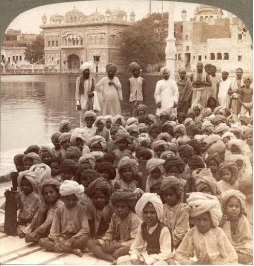 Indias of tommorow handsoms school boys in Amristor at the Golden Temple beside the holy tank