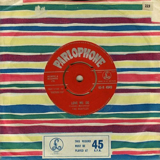 The Beatles Love Me Do b/w P.S. I Love You Parlophone Records 45 R 4949 Beach stripe Company sleeve colored wavy lines with Parlophone logo in a box on front