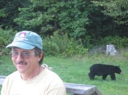 John on our porch with a visiting bear
