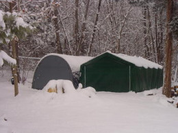 Both the Round and Peak (House) Style Portable Garage in Snow