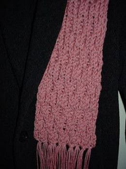 Pink honeycomb scarf with fringe.