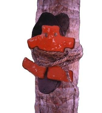 Creepy Haitian Poppet Nailed to Tree
