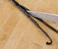 1.)  Split three vanilla beans with a knife or scissors.  Leave the top intact. No need to scrape out the seeds.