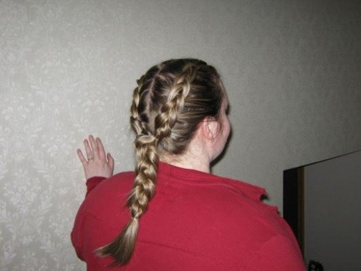 Day 23: I was starting to get stumped for ideas so I posted a message on my facebook asking for help. A double braid suggested. I divided my hair in half and pinned it with a clip while I braided one side. At the base of both braids I used an invisib