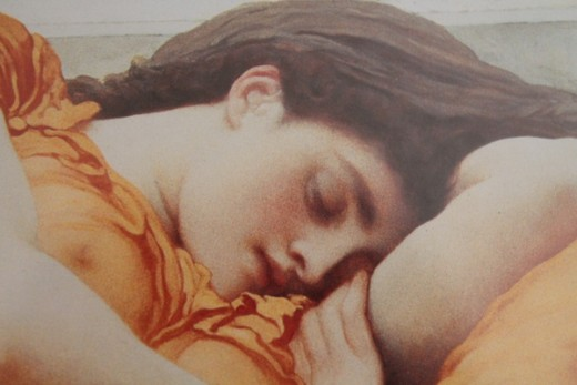 A close up of Flaming June's delicate face.