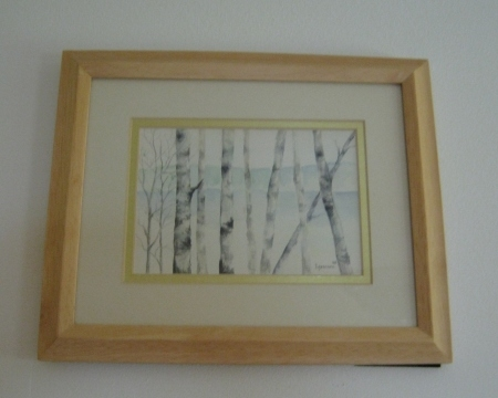 I love nature and windows. One of my girlfriends painted this water color of birches with water in the distance. It hangs above a door in my kitchen.