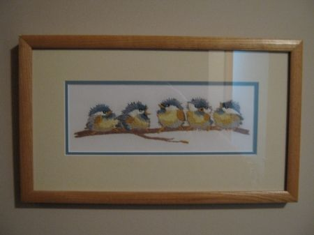 This was my first stitching project. My husband, then boyfriend matted and framed it for me.