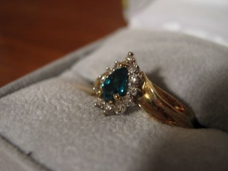 "This was the first ""real"" ring I bought myself. An honest to goodness emerald. I wouldn't have been able to afford it had I not been working in a jewelry store at the time."