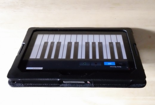 The leather case folded back and the piano app I downloaded.