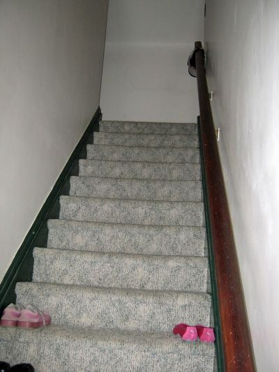 The stairs leading up to the apartment.