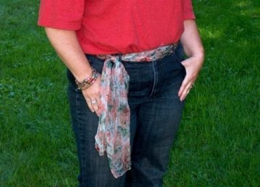 Glide a long scarf through loops of jeans and tie as belt.