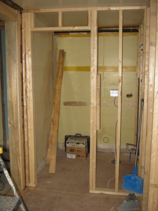 View of the powder room from the kitchen.