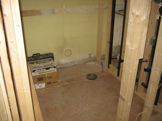 Closer look at the powder room which will have a sink and toilet.