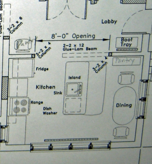 Here is a picture of the floor plan for the dining room which will soon be the kitchen. The plans give a good view of where the cupboards, appliances, and island will be. The only difference is the fridge will go on the other side of the wall and ext