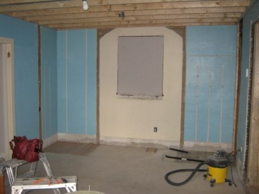 A view toward the back wall. The two mirror image closets have been removed and the decayed window was filled in.