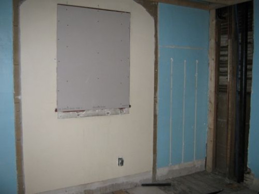 A closer look of where the mini closets were removed.