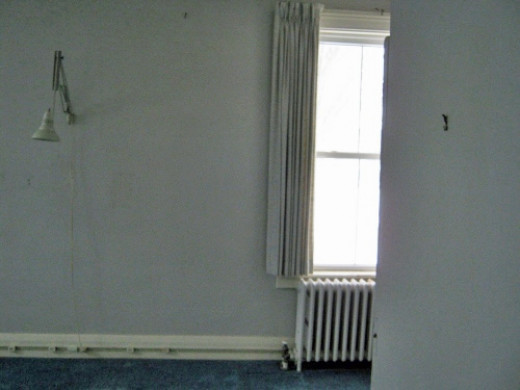 View of far said of bedroom toward storage space.