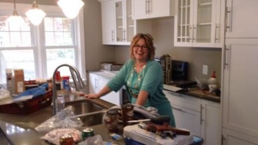 Lana in her masterpiece kitchen.