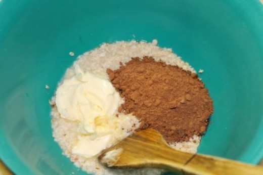 Add cocoa and 1/3 cup of margarine to hot oatmeal. Stir in until margarine is dissolved.