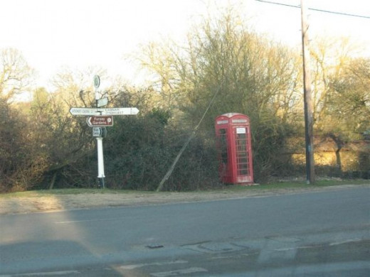 Old signpost and telephone box