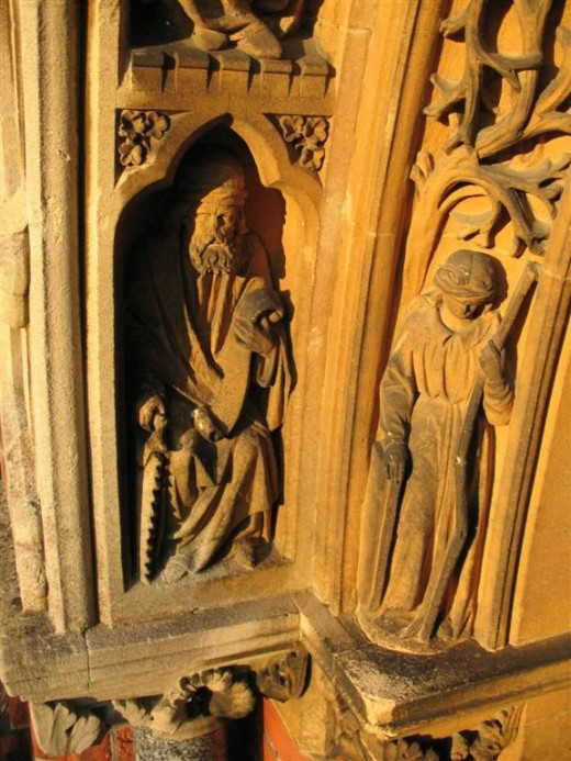Carvings of the Saints inside the entrance of Saint Michael & All Angels church in Lyndhurst