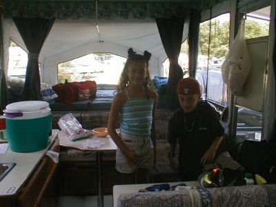 The Kids inside our popup on a happy camping adventure!