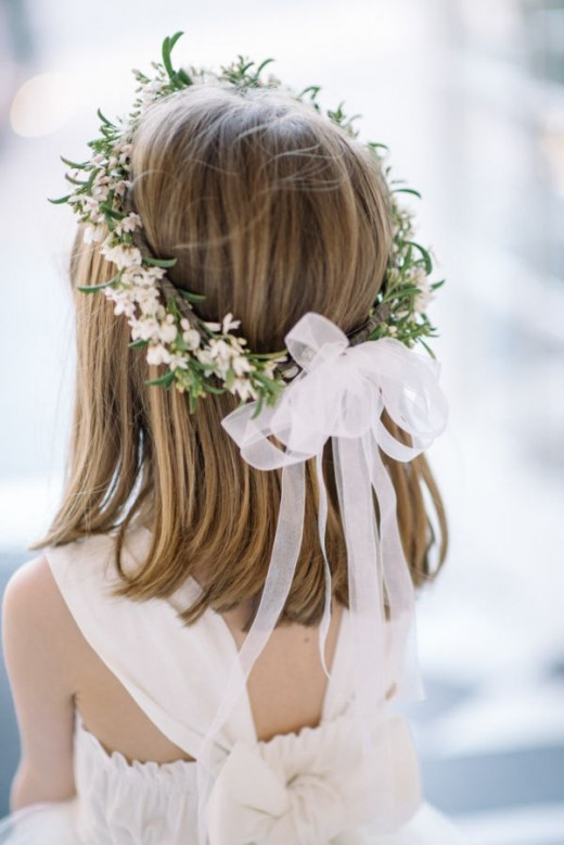 A bow tied to the back of a crown is really pretty in this one from Elizabeth Anne.http://www.elizabethannedesigns.com