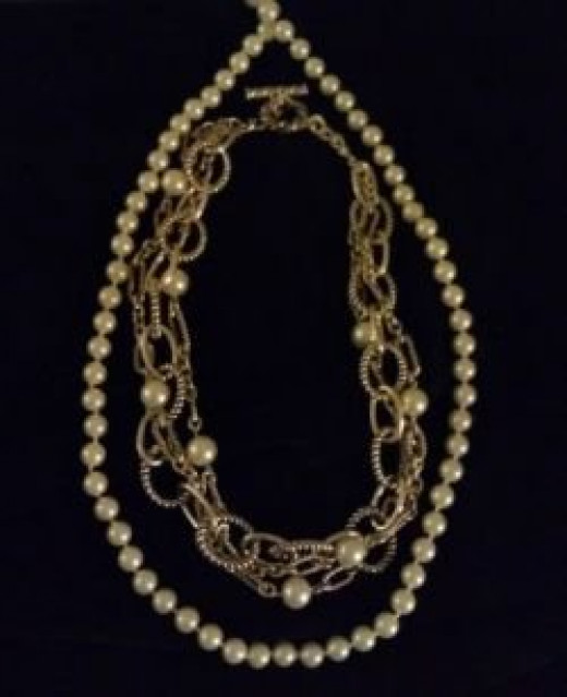 Photo mine.  Bellissimo necklace and faux pearls.