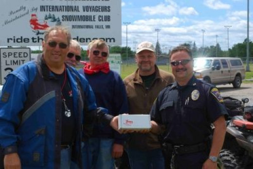 Larry Koch presents Wisconsin Chees to IFPD