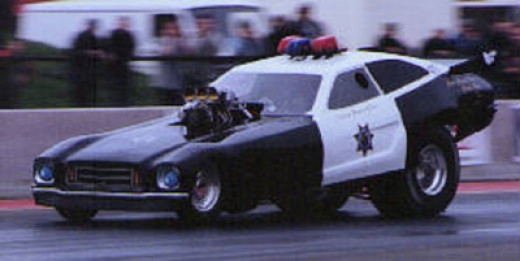 "The police car theme has been used several times in funny car racing. Here is Great Britain's Wendy Baker in the ""Cop Car"""